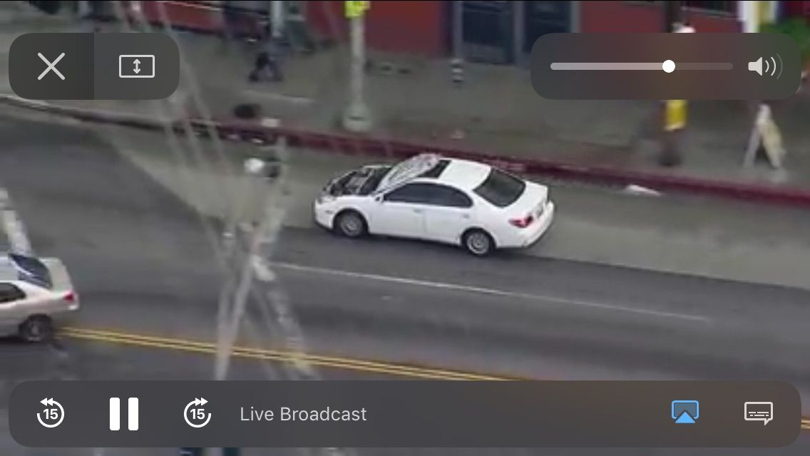 car with hood over windshield